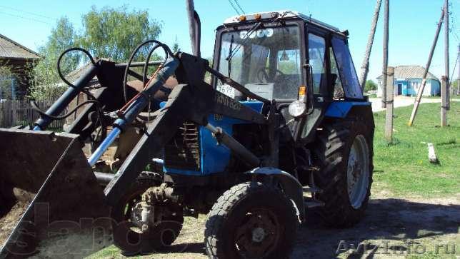 Трактор МТЗ Беларус 1221.2 с погрузчиком Универсал и бревнозахватом